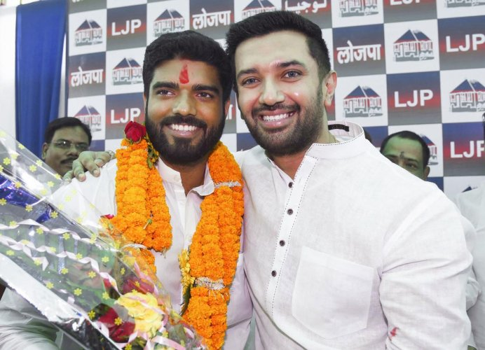 Lok Janshakti Party (LJP) parliamentary board chairman Chirag Paswan poses with the party's newly elected MP from Samastipur, Prince Raj, during a press conference in Patna, Friday, Oct. 25, 2019. (PTI Photo)