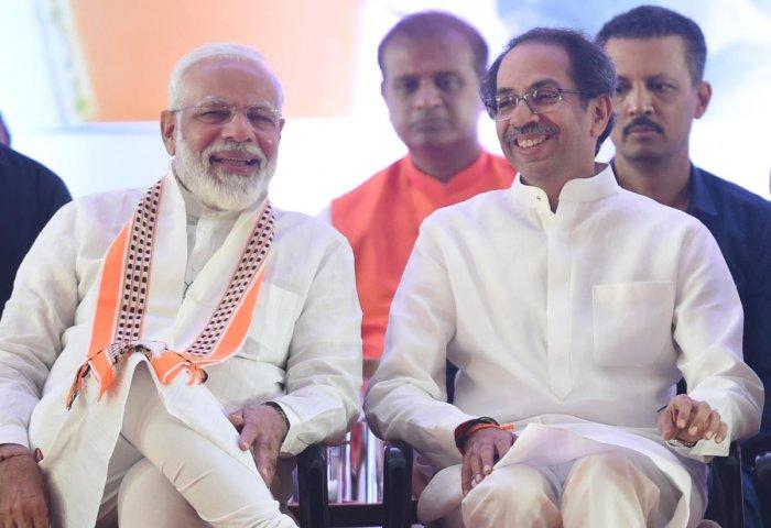 : Prime Minister Narendra Modi with Shiv Sena president Uddhhav Thackeray. (PTI Photo)