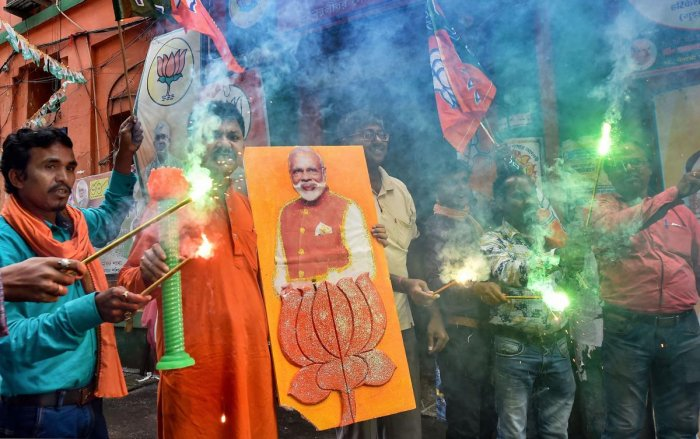 BJP Workers celebrates their victory in Maharashtra Assembly elections, in Kolkata, Thursday, Oct. 24, 2019. (PTI Photo)