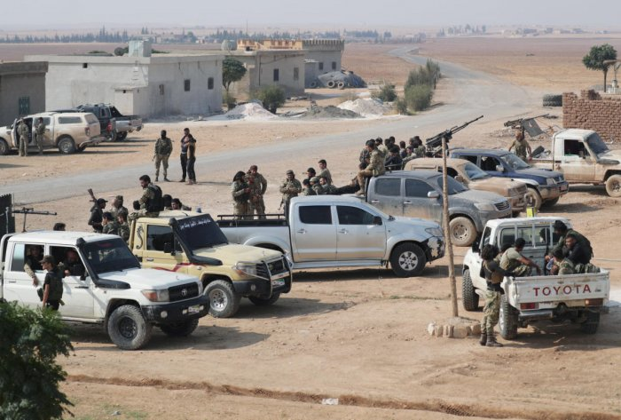 Turkey-backed Syrian rebel fighters gather near the border town of Tal Abyad. (REUTERS Photo)