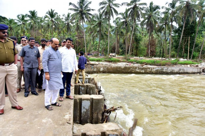 Home Minister Basavaraj Bommai inspects flood-hit areas in Aranepade in Belthangady taluk on Thursday.