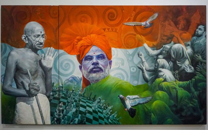 In this undated photo, a view of a painting of Prime Minister Narendra Modi at National Gallery of Modern Art in New Delhi. The exhibition cum e-auctioning of mementos received by PM Modi drew to a close on Friday with the highest bid of Rs 25 lakh for a painting of the PM with Mahatma Gandhi. (PTI Photo)
