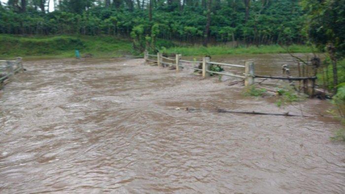 Water from a stream overflows on Kalasa-Balehonnur road at Magundi Mahalgodu near Balehonnur.