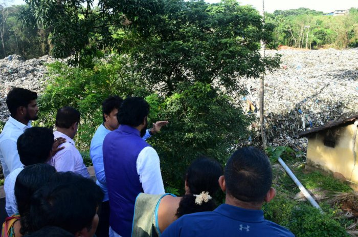 File DH picture of Health Minister Sriramulu visiting garbage slide affected areas