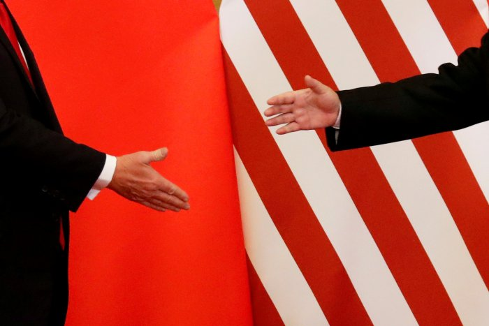 US President Donald Trump and China's President Xi Jinping shake hands after making joint statements at the Great Hall of the People in Beijing, China. (Reuters Photo)