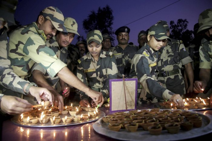 Border Security Force (BSF) soldiers light candles during Diwali celebrations near the international border outskirts in Jammu, Saturday, Oct. 26, 2019. (PTI Photo)
