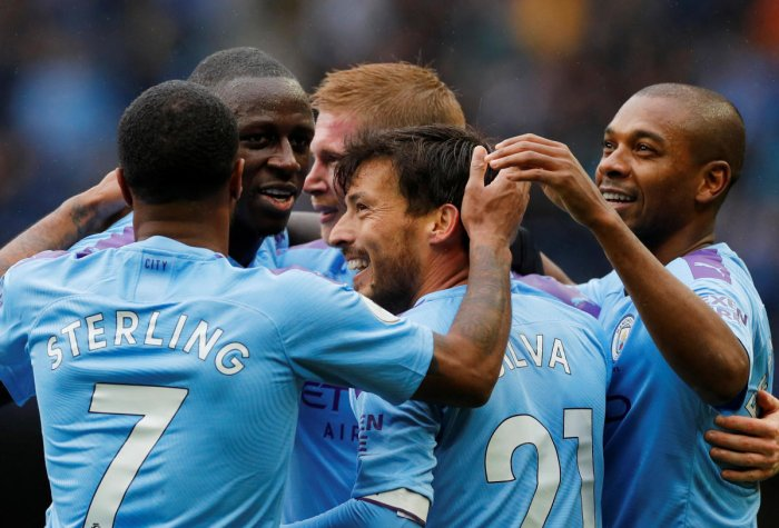 Manchester City's Kevin De Bruyne celebrates scoring their second goal with team mates. REUTERS/Phil Noble