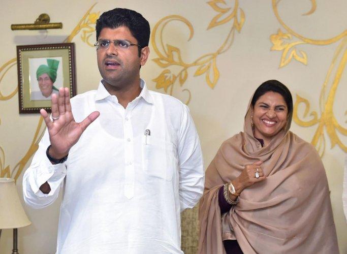 Jannayak Janata Party chief Dushyant Chautala and his mother Naina Chautala. PTI Photo