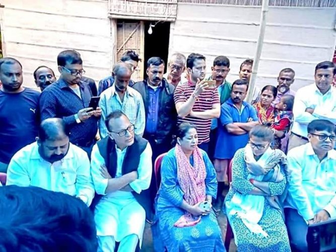 A Congress team visiting Dulal Paul's family in Sonitpur district in Assam. (DH photo)