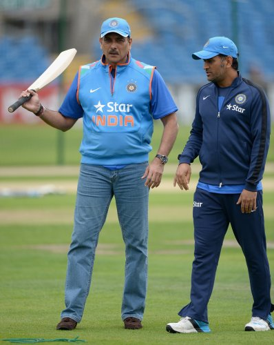 Taking a dig at the people criticising Dhoni, Shastri said that 'half the guys commenting on MS Dhoni can't even tie their shoelaces.' Photo/Getty