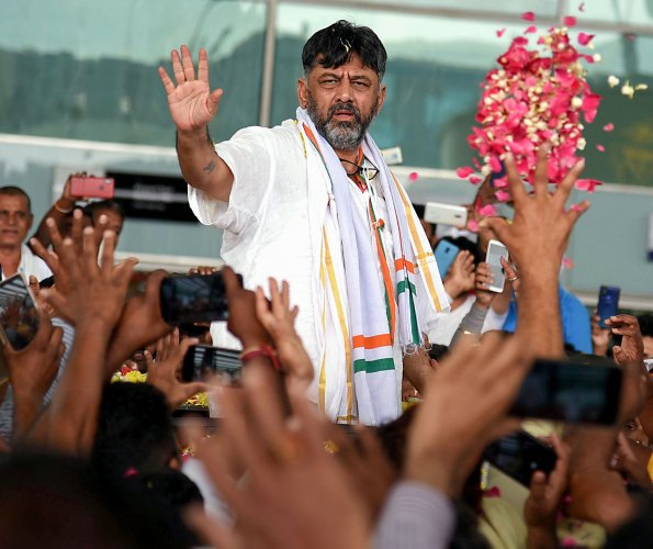 Congress leader D K Shivakumar being welcomed by his supporters on his arrival in Bengaluru. (PTI Photo)