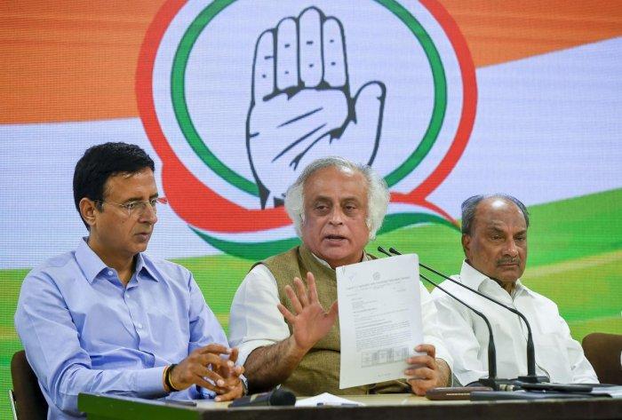 (L-R) Senior Congress leaders Randeep S Surjewala, Jairam Ramesh and AK Anthony. (PTI Photo)