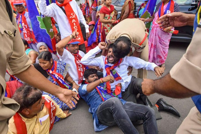 BLF, MCPI (U) activists being detained by police during a protest at Bus Bhavan in solidarity with RTC employees strike in Hyderabad, Friday, Oct. 25, 2019. (PTI Photo)