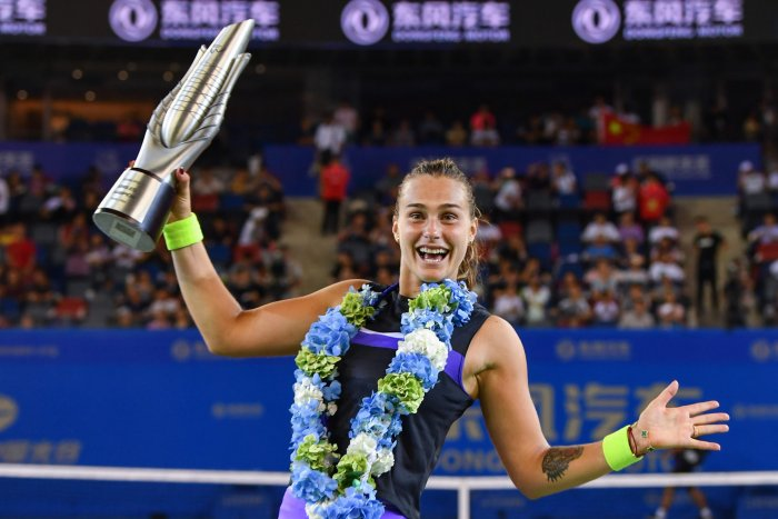 Aryna Sabalenka of Belarus holds the trophy after her victory in the women's singles final match against Alison Riske of the US at the Wuhan Open tennis tournament in Wuhan. (AFP PHoto)