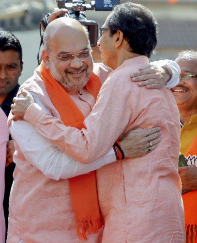 File PTI photo of BJP National President Amit Shah and Shiv Sena chief Uddhav Thackeray
