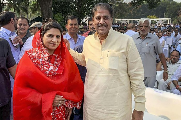 Jannayak Janta Party leader Dushyant Chautala's father Ajay Chautala and mother Naina Singh Chautala arrive to attend the swearing-in ceremony of their son as Deputy Chief Minister of Haryana, in Chandigarh, Sunday, Oct. 27, 2019. (PTI Photo)