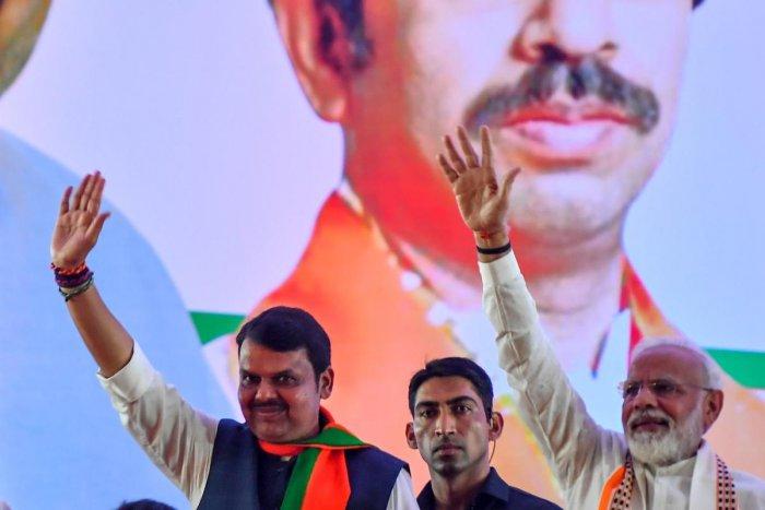 India's Prime Minister Narendra Modi (R) gestures along with Devendra Fadnavis (L). AFP file photo