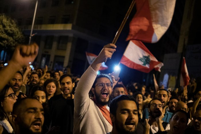 Demonstrators shout slogans during ongoing anti-government protests in downtown Beirut, Lebanon, October 26, 2019. REUTERS/Alkis Konstantinidis