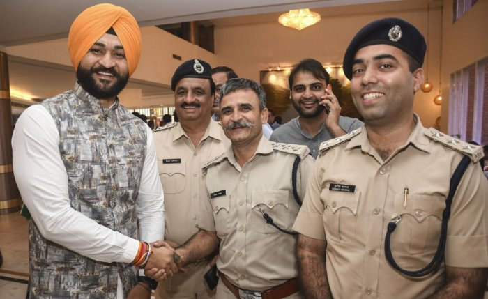 Former hockey captain and newly-elected BJP MLA meets police officials in Chandigarh, Saturday, Oct. 26, 2019. (PTI Photo)