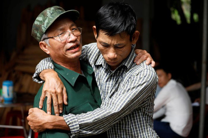 Nguyen Dinh Gia, father of Vietnamese Joseph Nguyen Dinh Luong who is one of the suspected victims of the 39 people found dead in a refrigerated truck in Britain, is embraced by a friend at his home in Ha Tinh province, Vietnam October 27, 2019. REUTERS/Kham