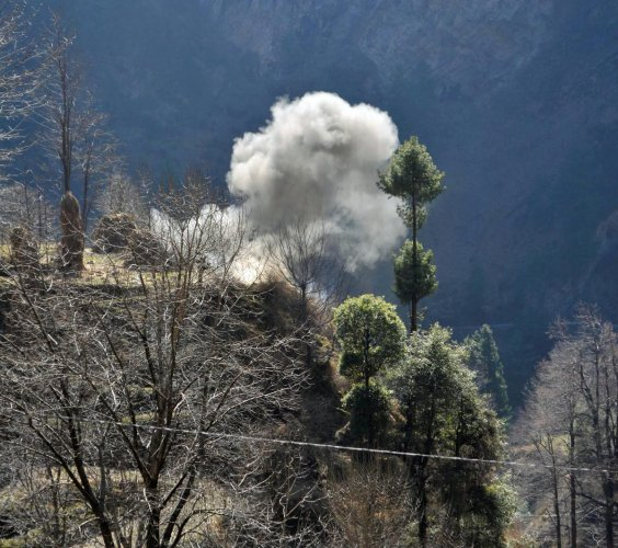 Smoke rises after firing of a mortar shell by Pakistani Army near the Line of Control (LoC). (PTI Photo)
