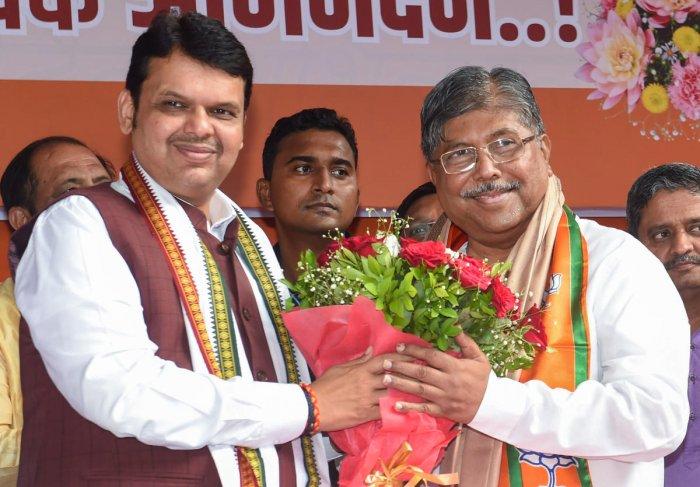 Chief Minister Devendra Fadnavis and BJP State President Chandrakant Patil (PTI Photo)