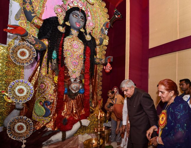 West Bengal Governor Jagdeep Dhankhar and his wife Sudesh Dhankhar during inauguration of a community Kali Puja pandal in Kolkata. (PTI Photo)