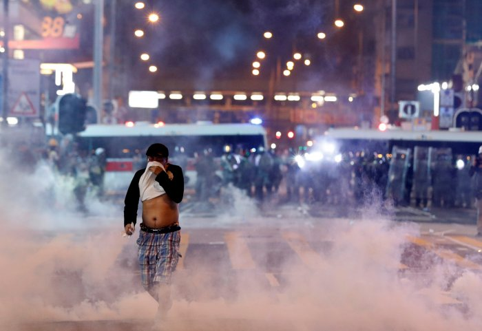 A man runs among the tear gas during a protest in Hong Kong, China. (Reuters Photo)