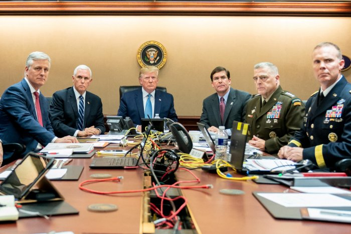 Donald Trump, US Vice President Mike Pence (2nd L), US Secretary of Defense Mark Esper (3rd R), along with members of the national security team, watch as US Special Operations forces close in on ISIS leader Abu Bakr al-Baghdadi, in the Situation Room of the White House in Washington, October 26, 2019. (Shealah Craighead/The White House/Handout via REUTERS)