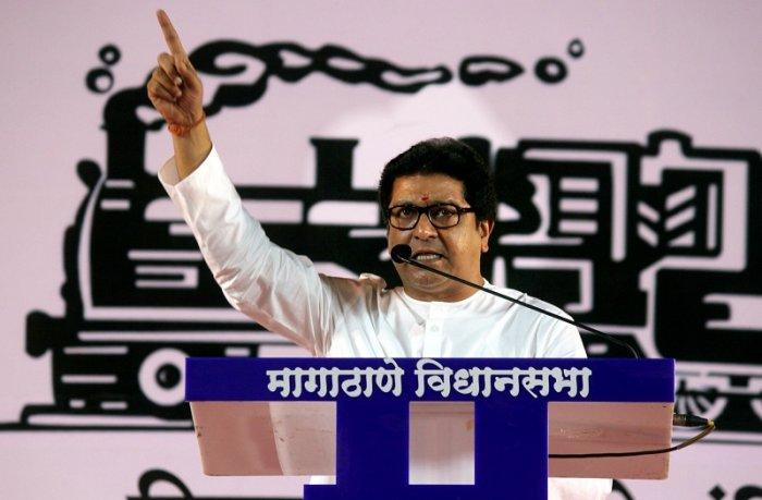 Maharashtra Navnirman Sena chief Raj Thackeray addresses a public meeting during a rally for the upcoming Assembly elections, at Borivali in Mumbai. (PTI Photo)