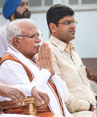 Haryana's new Chief Minister Manohar Lal Khattar and Deputy Chief Minister Dushyant Chautala after taking oath during a swearing-in ceremony, in Chandigarh. (PTI Photo)