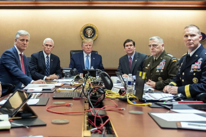In this photo provided by the White House, President Donald Trump is joined by from left, national security adviser Robert O'Brien, Vice President Mike Pence, Defense Secretary mark Esper, Joint Chiefs Chairman Gen. Mark Milley and Brig. Gen. Marcus Evans, Deputy Director for Special Operations on the Joint Staff, Saturday, Oct. 26, 2019, in the Situation Room of the White House in Washington. monitoring developments as in the U.S. Special Operations forces raid that took out Islamic State leader Abu Bakr