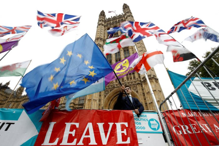An anti-Brexit protester waves an EU flag outside the Houses of Parliament in London. (Reuters Photo)