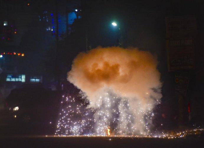 Smoke rises as people burn crackers during 'Diwali' celebrations, in New Delhi, Sunday, Oct. 27, 2019. (PTI Photo)