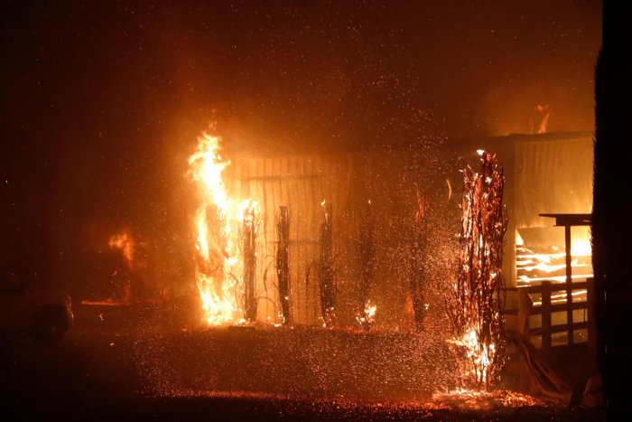 A burning structure is seen during the wind-driven Kincade Fire in Windsor, California. (Reuters Photo)