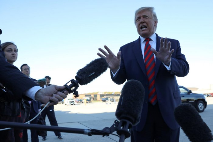 US President Donald Trump talks to reporters prior to boarding Air Force One and departing Washington for travel to Chicago at Joint Base Andrews, Maryland on October 28, 2019. (REUTERS)
