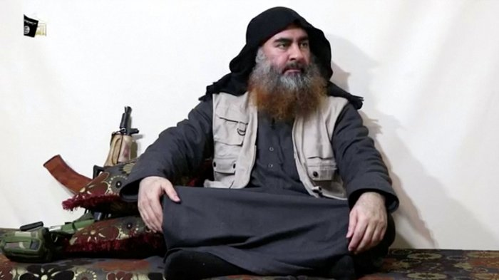 A bearded man with Islamic State leader Abu Bakr al-Baghdadi's appearance speaks in this screen grab taken from video released. (Reuters Photo)