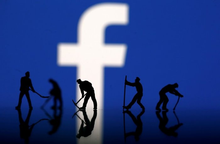 Figurines are seen in front of the Facebook logo in this illustration taken. (Reuters Photo)