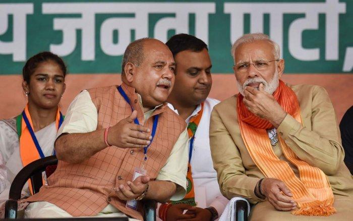 Prime Minister Narendra Modi with Union Minister and Narendra Singh Tomar. PTI Photo