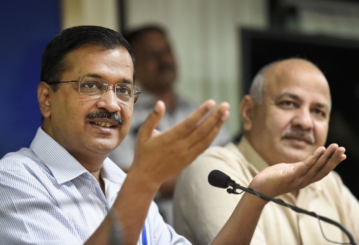 Delhi Chief Minister Arvind Kejriwal with his deputy Manish Sisodia addresses a press conference, in New Delhi. (PTI Photo)