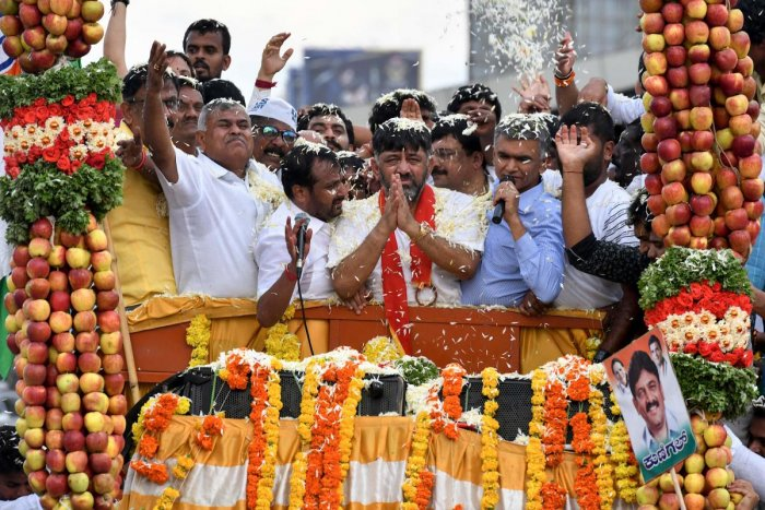 Former Karnataka Congress Minister D.K. Shivakumar (C) gestures to greet party workers. AFP file photo