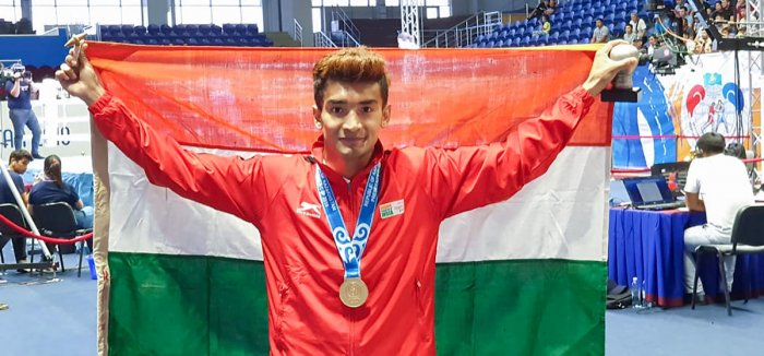 Four-time Asian Championships medallist Shiva Thapa poses for a photo after winning gold. (PTI Photo)