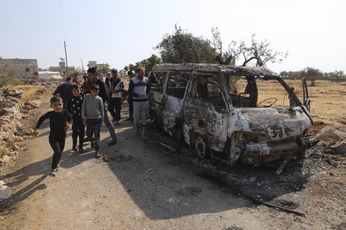 People look at a destroyed van near the village of Barisha, in Idlib province, Syria, Sunday, Oct. 27, 2019, after an operation by the U.S. military which targeted Abu Bakr al-Baghdadi, the shadowy leader of the Islamic State group. (AP/PTI)