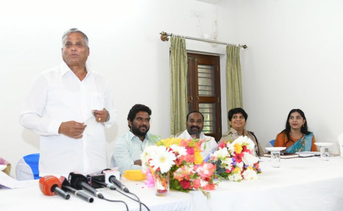 District In-charge Minister V Somanna addresses officials during a meeting at HD Kote in Mysuru district on Sunday. MLA C Anil, ZP Member Venkataswamy, Additional Superintendent of Police P V Sneha and Hunsur Sub-Division Assistant Commissioner B N Veena