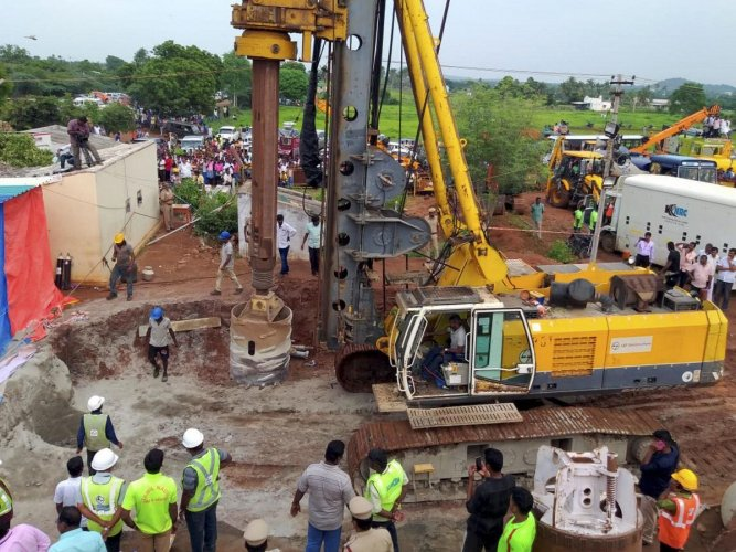 Rescue operation underway to retrieve a boy Sujith who fell into an open borewell on Friday, in Tiruchirapalli on Monday. (PTI Photo)