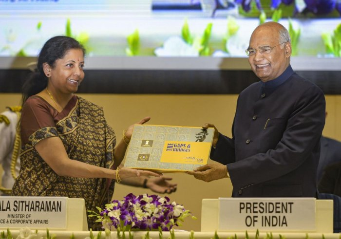 President Ram Nath Kovind being presented a book by Finance Minister Nirmala Sitharaman during the National Corporate Social Responsibility Awards function in New Delhi on Tuesday. (PTI Photo)