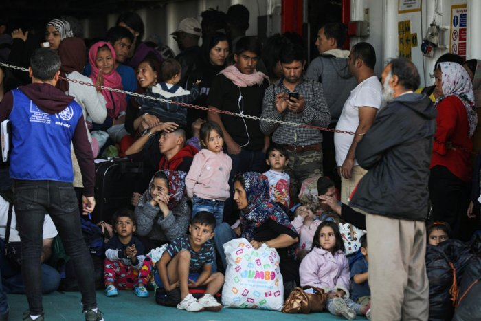 Refugees and migrants arrive on a passenger ferry from the island of Samos, at the port of Elefsina near Athens Greece (Reuters Photo)
