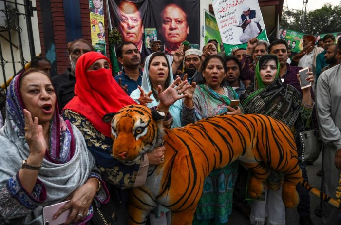 Supporters of Pakistan's former prime minister Nawaz Sharif shout anti-government slogans outside a hospital, where Nawaz was admitted after his condition deteriorated, in Lahore on October 29, 2019. ( AFP)