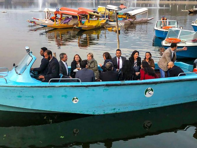 Members of European Union Parliamentary delegation during a shikara ride at Dal Lake in Srinagar, Tuesday, Oct. 29, 2019. Protest broke out in many parts of the city as European Union MPs visited the valley. (PTI Photo)