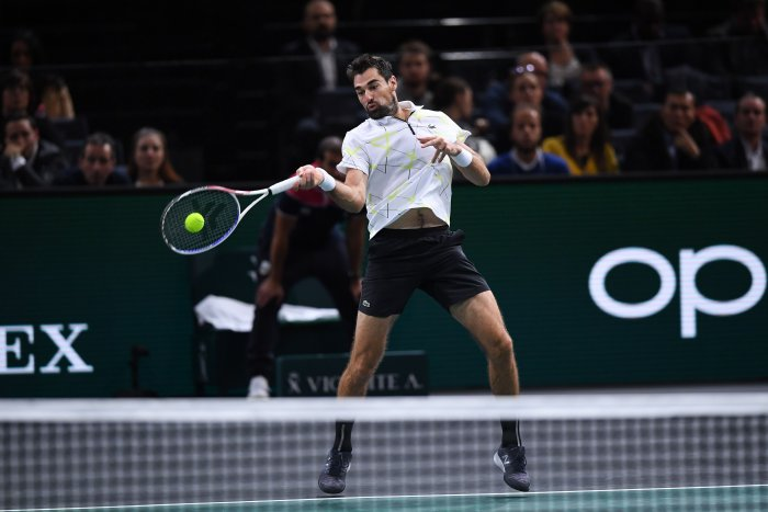 France's Jeremy Chardy returns the ball to Russia's Daniil Medvedev during their men's singles tennis match on day two of the ATP World Tour Masters 1000 - Rolex Paris Masters - indoor tennis tournament at The AccorHotels Arena in Paris. (AFP Photo)